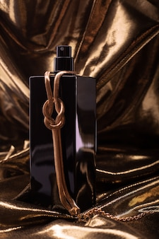 Perfume and gold jewelry