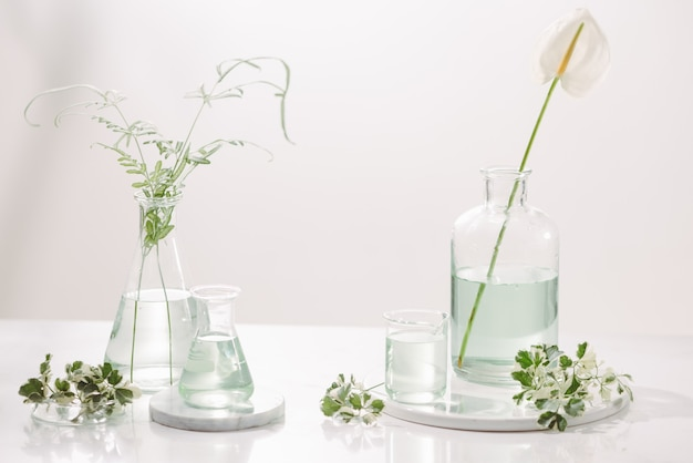 Perfume oils concept. laboratory glassware with infused floral water on table