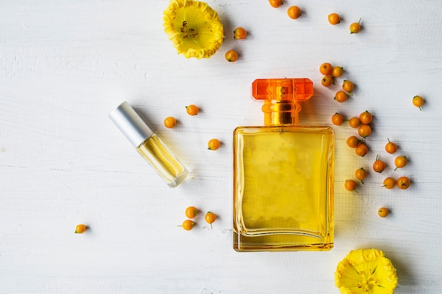 Perfume and perfume bottles with yellow flowers
