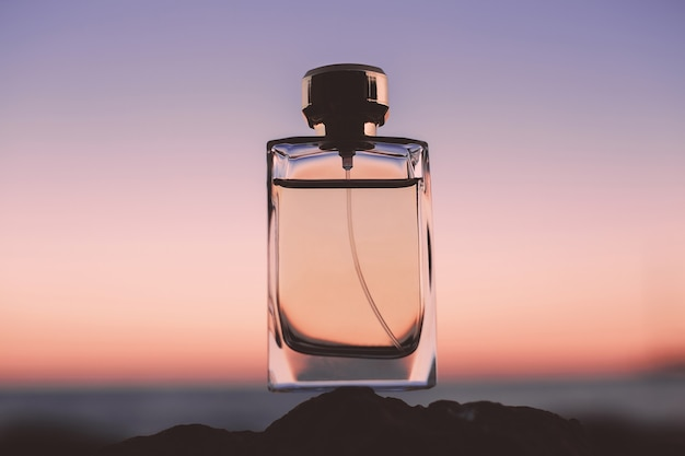 Perfume on the sea at sunset