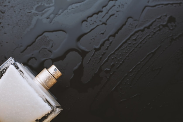 Perfume on a wet black background