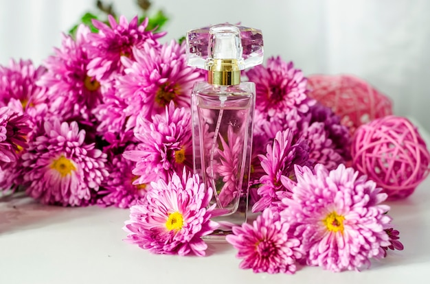 Perfume with floral scent and flowers
