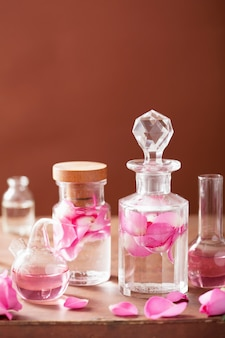 Perfumery and aromatherapy set with rose flowers and flasks