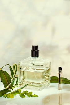 Perfumery in a spray bottle on green