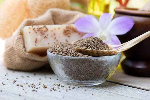 Perilla seeds and soap on nature background.