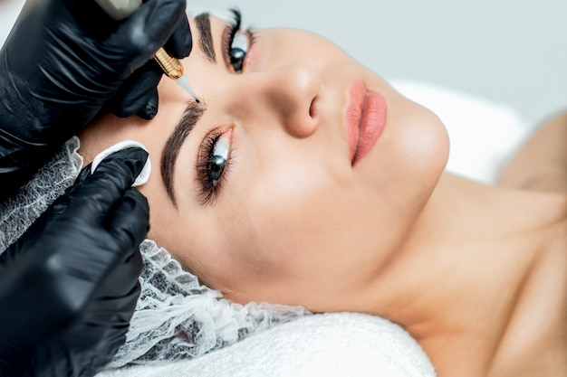 Permanent makeup on eyebrows.