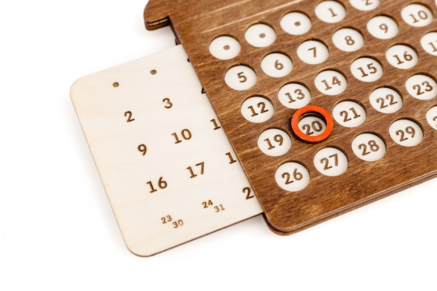 Perpetual wooden calendar in the shape of a house.
