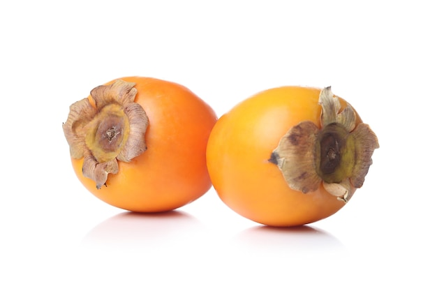 Persimmons on a white surface