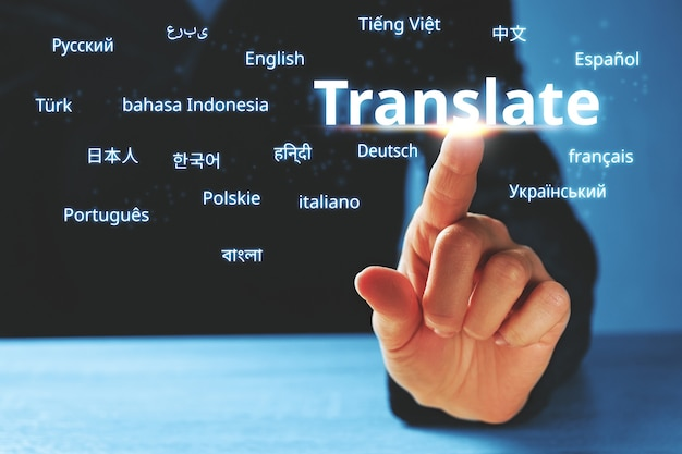 Person abstractly presses on the display with the word translate and foreign languages.