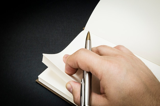 A person beginning to write