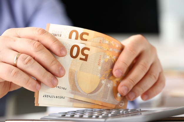 Person calculate euro budget tax report concept