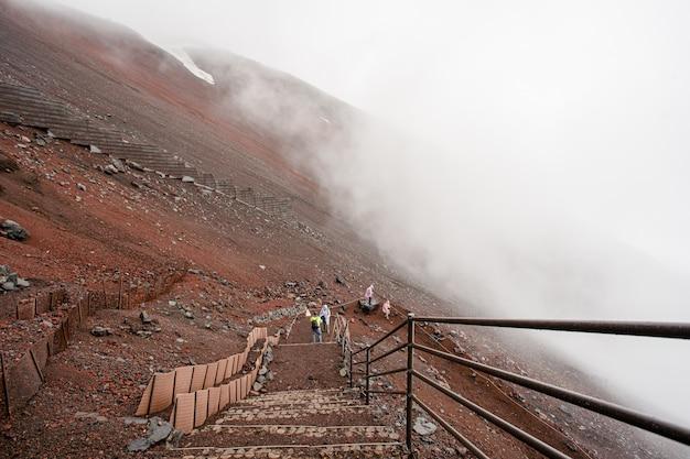 Person climbing to fuji mountain