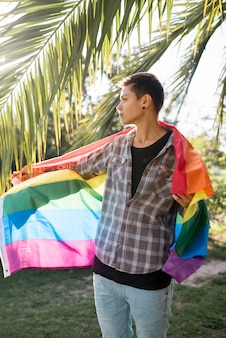 Person covering in lgbt flag