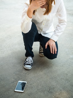 Person droped smartphone on floor