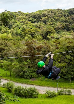 A person enjoying ride of zip line adventure in costa rica forest