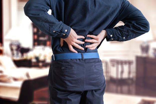A person feeling the backache, stress overworking disease problem