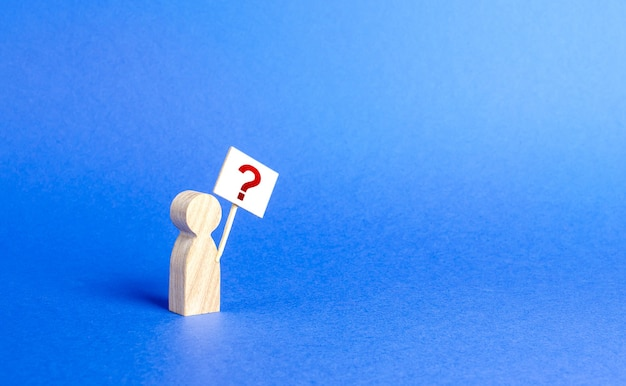 A person figurine with a question mark minimalism asking searching for truth and demanding truth