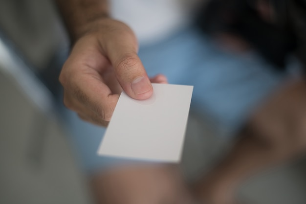 Person giving business card