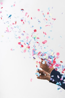 Person hands and colorful confetti