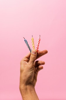 Person holding birthday candles