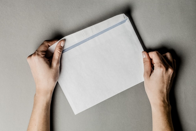 Person holding blank envelope