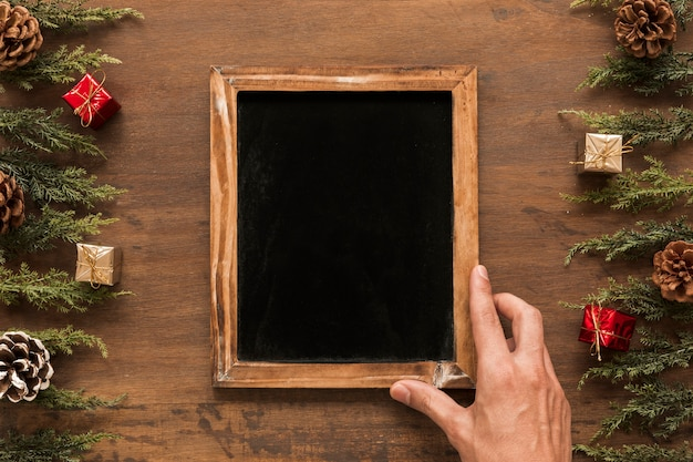 Person holding chalkboard on table