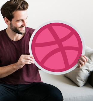 Person holding a dribbble icon