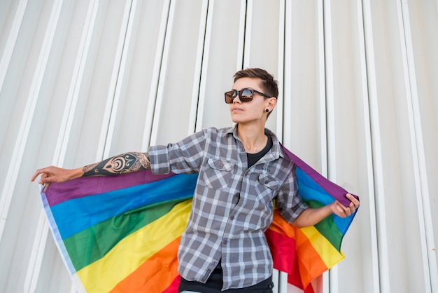 Person holding lgbt flag