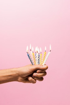 Person holding lit birthday candles
