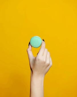 A person holding macaron
