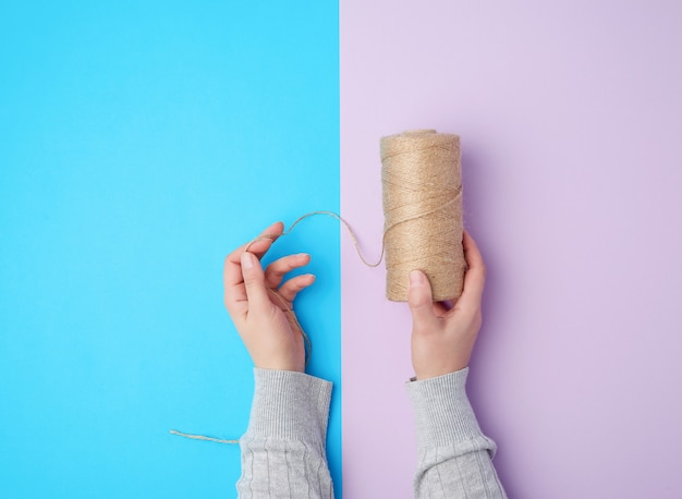 Person holding a skein with brown eco thread