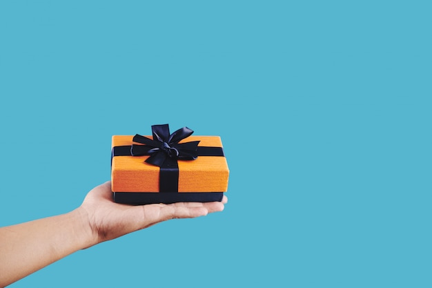Person holding small gift