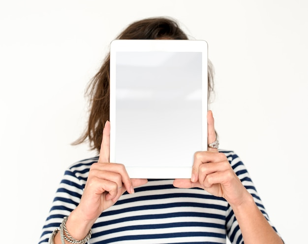 Person holding tablet studio portrait concept