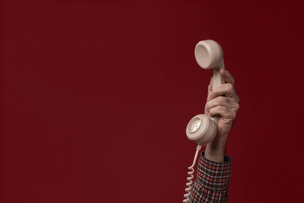 Person holding a telephone