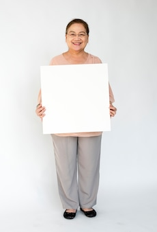 A person holding a white board