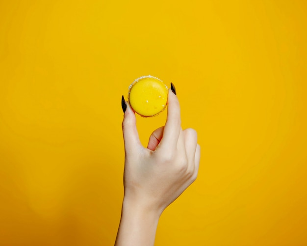 A person holding yellow cookie background