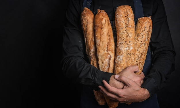 Person hugging loaves of bread