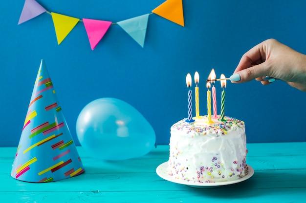 Person Lighting Up Homemade Cake