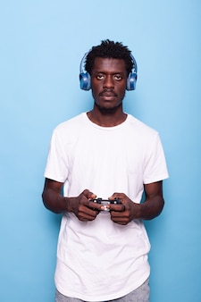 Person looking at camera while using controller and headphones