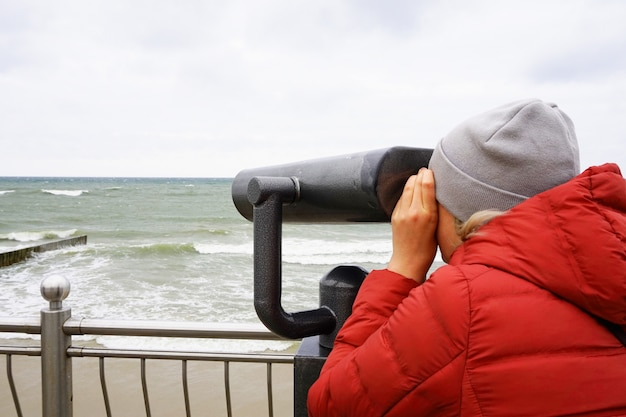 Person looks through a telescope