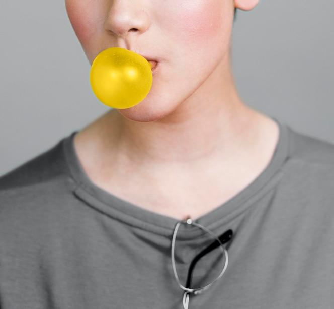 person making an illuminating bubble gum