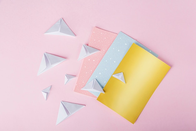 Person making origami with colorful papers