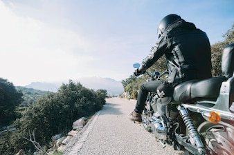 Person on nice motorbike in countryside