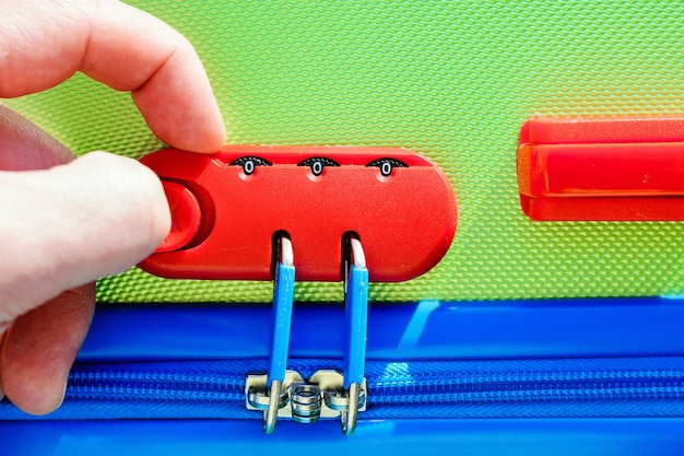 Person opens a locking mechanism on the suitcase