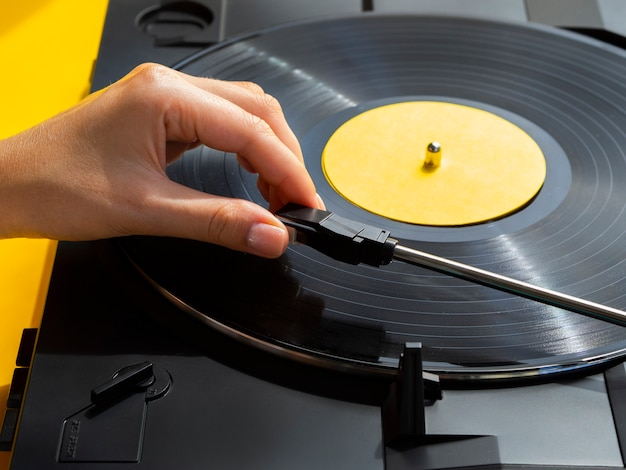 Person placing vinyl record in player