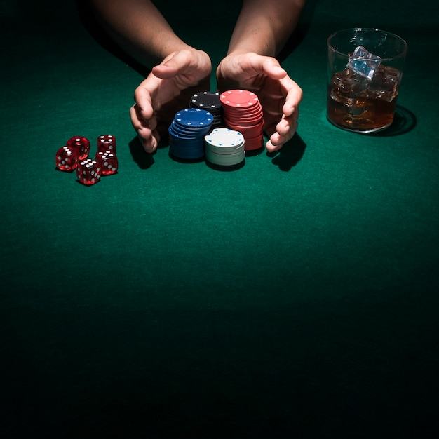 A person playing poker in casino