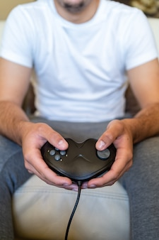 Person playing video games on a sofa