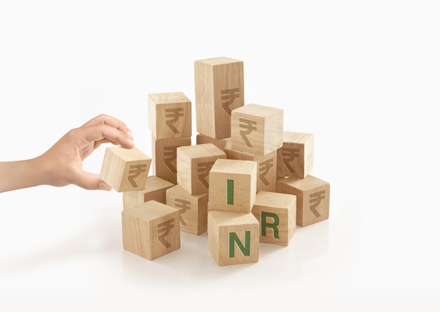 Person playing with wooden toy blocks