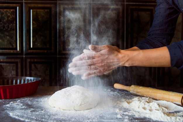 Person preparing dough front view