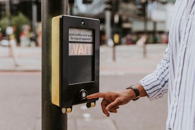 Person pressing a pedestrian cross push button